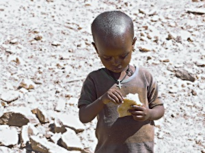 Child with some bread in the hand